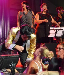 """Elvis Tribute Artist Dean Zeligman (Dean Z) greets a fan Saturday night during the signature """"This is Elvis"""" show at the Collingwood Elvis Festival."""